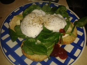 Perfect little poached eggs (one a double yolker) on fresh homemade scones with spinach
